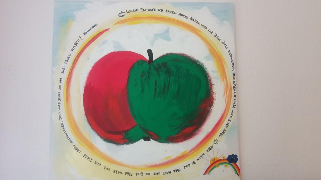 Spruch mit einem Apfel